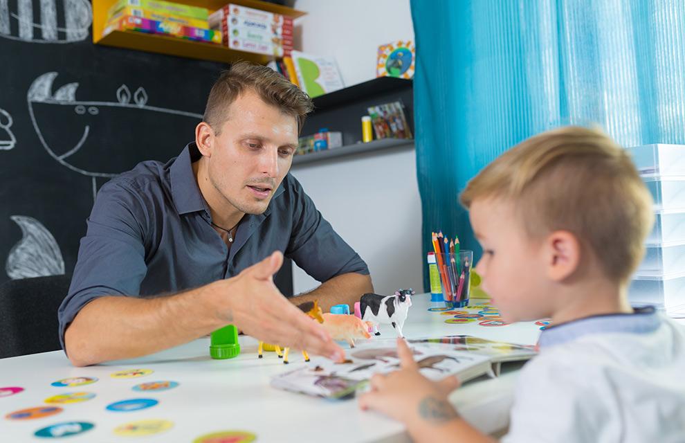 male teacher evaluates a child