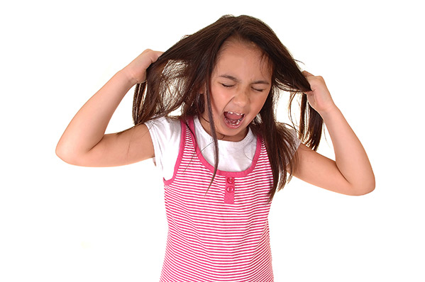 girl screaming and holding her hair